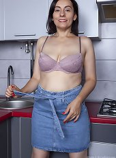 Allegra poses naked in her kitchen